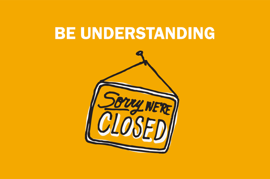 "A drawn ""open & closed"" sign that says ""Be understanding""."
